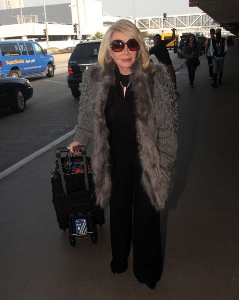 Joan Rivers Catches A Flight At LAX Airport