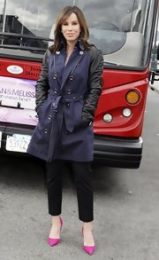 Melissa Rivers sported a chic navy and black leather trench as her Mom was honored at Gray Line's 'Ride of Fame'.