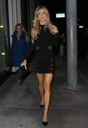 Joanna Krupa flaunted her slim figure and fabulous pins in a grommeted black cutout dress while enjoying a night out at Catch.