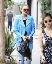 Gigi Hadid stepped out in West Hollywood looking edgy-chic in mirrored aviators and a biker jacket.