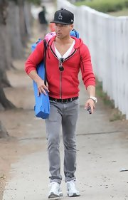 Joey Lawrence chose a casual red zip-up hoodie for his look while out with his daughters.