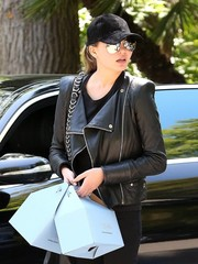 Chrissy Teigen accessorized with a black suede baseball cap and mirrored aviators while out in Bel-Air.