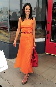 Jordana Brewster looked bright and fun in a striped tangerine maxi that featured a swirl-designed matching belt.