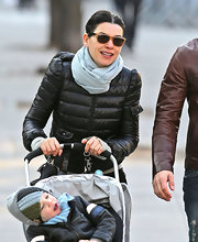 Julianna Margulies went for a walk in tortoiseshell and black Ray-Ban wayfarers.