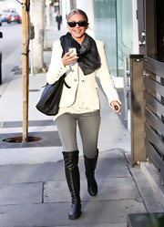 Julianne Hough tied her look together with a black leather bag and matching over the knee boots.