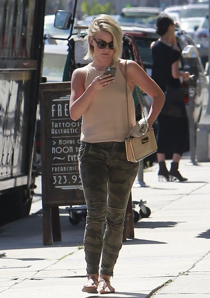 'Paradise' actress Julianne Hough is distracted with her phone after having lunch on Melrose in Los Angeles, California on August 16, 2013.