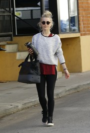 Julianne Hough sealed off her workout attire with a pair of high-top leather sneakers.