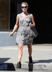 Julianne kept her daytime look minimal and relaxed with a gray, printed dress.