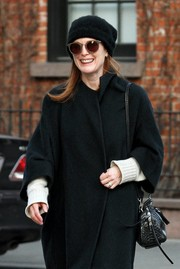 Julianne Moore stayed warm with a black wool beret and a matching coat.