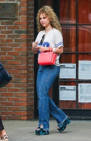 Juno Temple teamed her shirt with a pair of bootcut jeans.