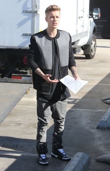 Justin Bieber coordinated his jacket with a pair of gray jeans.