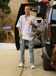 Justin Bieber finished off his look in edgy style with a pair of ripped jeans.