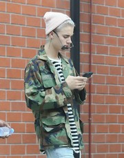 Justin Bieber tamed his hair with a baby-pink knit beanie for a day out in Beverly Hills.