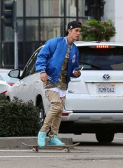 Justin Bieber teamed a blue track jacket by Chalk Line with a camo shirt and chinos for a day out in Beverly Hills.