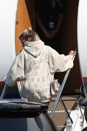 Sofia Richie kept it comfy in an oversized hoodie from Kanye West's Pablo merchandise for a flight.