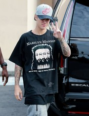 Justin Bieber donned a Detroit Red Wings cap by Mitchell & Ness for a day out in LA.