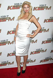 Paris Hilton was a red carpet flirt in black patent platform pumps.