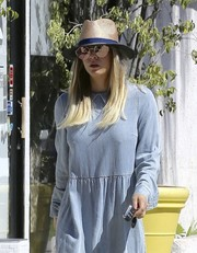 For extra sun protection, Kaley Cuoco teamed her shades with a straw fedora.