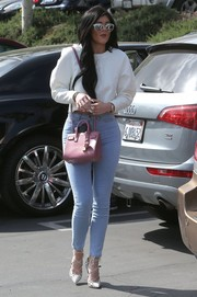 Kylie Jenner's pink Saint Laurent Sac De Jour provided a nice contrast to her pastel-blue jeans.