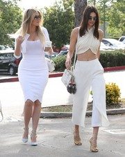 Kendall Jenner accessorized her outfit with a small white Saint Laurent Sac De Jour.