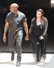 Kanye chose a classic black short-sleeved button down for his monochromatic look while out with Kim Kardashian.