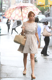 Kara  Young sported a sweet floral day dress, even though it was raining.