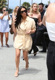 Kim Kardashian covered up her curves in an oversized belted jacket for a visit to the La Valencia Hotel.