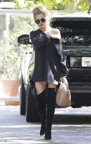 Khloe Kardashian added some zing with a pair of thigh-high suede boots by Gianvito Rossi.