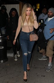 Khloe Kardashian teamed her super-sexy top with a pair of ripped jeans by Topshop.