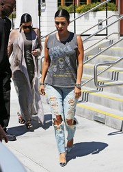 Kourtney Kardashian continued the grunge-chic vibe with majorly distressed jeans by Citizens of Humanity.