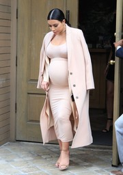 Kim Kardashian topped off her all-blush ensemble with a wool coat.