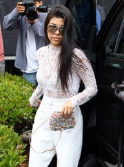 Kourtney Kardashian arrived for Easter church service wearing cool Porsche aviators.