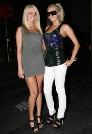 Looks like the twins finally got over they're matching ensembles. Kristina wore a pair of black leather bandage heels with her white skinny jeans.