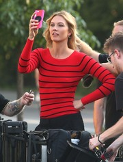 Karlie Kloss struck a pose wearing a cute red and black striped sweater while doing a photo shoot in New York City.