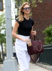 Karlie Kloss sported a cool pair of mirrored shades for a day out in New York City.