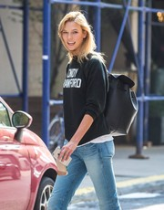 Karlie Kloss teamed a black Mansur Gavriel leather backpack with a 'Cindy Crawford' sweatshirt for a day out in New York City.