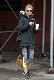 Karlie Kloss kept it comfy in a pair of printed leggings while walking her dog.