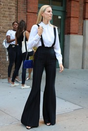 Karolina Kurkova teamed her bell-bottoms with a long-sleeve white blouse.