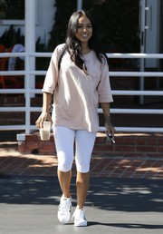 Karrueche Tran pulled her casual outfit together with a pair of Adidas sneakers.