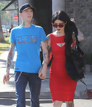 Kat Von D couldn't of looked more retro in her fire engine red embellished cateye sunglasses.
