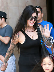 Kat Von D paired her large shades with long jet black locks.