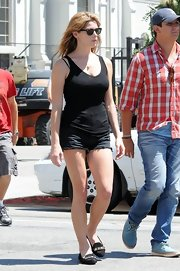 Ashley Greene kept it simple on set when she wore a basic black tank and shorts.
