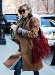Kate Hudson got majorly boho with this fringed red hobo bag while out in New York City.
