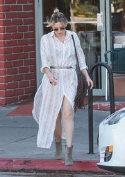 Kate Hudson styled her frock with gray suede ankle boots by Isabel Marant.