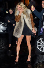 Kate Moss topped off her mini dress with black platform pumps.