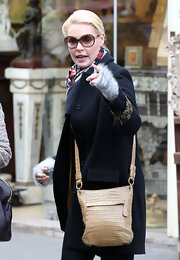 Katherine Heigl traveled light with a small croc crossbody bag slung over her shoulder.
