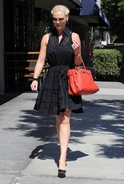 Katherine Heigl looked chic and statuesque in a black eyelet shirtdress while out for lunch in Studio City.