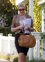 Katherine Heigl toughened her polished look with a caramel leather jacket with cropped sleeves.