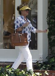 Carrying a brown Birkin tote, Kathy Hilton was one chic shopper.