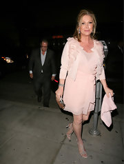 Kathy Hilton stepped out for dinner looking glam in a pale pink wrap dress with a matching embellished cardigan.